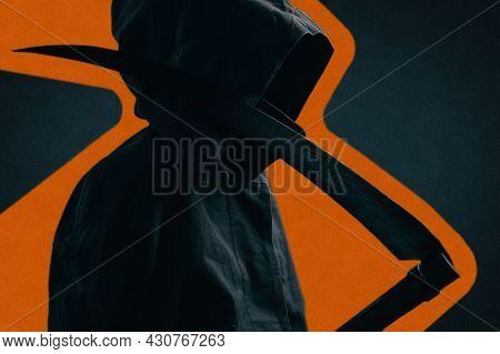 Grim Reaper In A Black Cloak With A Scythe.