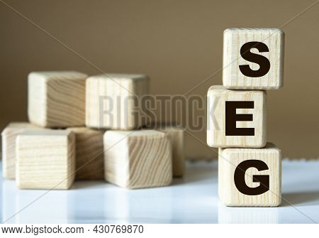 Seg (standardization Evaluation Group) - Acronym Nadrevyannye Cubes On A Brown Background