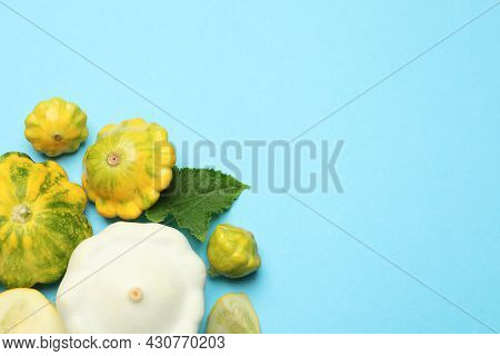 Fresh Ripe Pattypan Squashes On Light Blue Background, Flat Lay. Space For Text