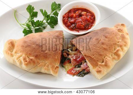calzone,folded pizza,like a half moon,italian food