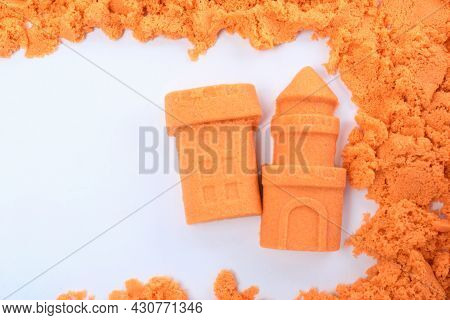 Castle And Tower Made Of Kinetic Sand On White Background, Top View