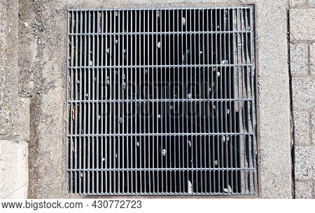 Steel Grating Cover With Stone Stuck On.steel Grating Cover On Street Sewer Drain Manhole.