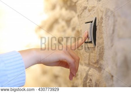 Close Up Of A Woman Hand Turning On The Light At Home