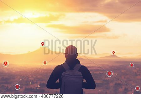 Backpacker Man Standing At Top Of Mountain Looking View Landscape With Navigator Gps Location Abstra