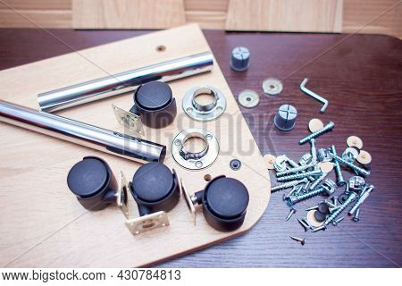 Fasteners For Collecting Furniture. A Set Of Fasteners For Assembling A Table