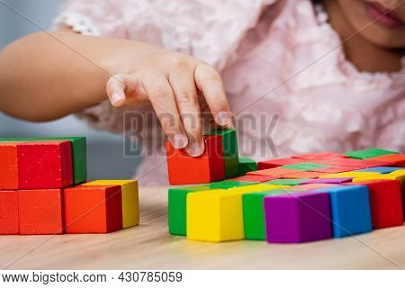 The Hands Of A Child With Long Nails Playing With Colorful Wooden Blocks. Concept Of Cleanliness Whe
