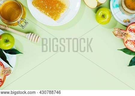 Honey, Apple And Pomegranate On A Mint-green Background. Concept Jewish New Year Happy Holiday Rosh