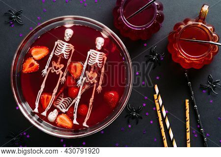 Happy Halloween Holiday Party Composition With Bowl Of Bloody Drink, Skeletons, Drinking Straws On B