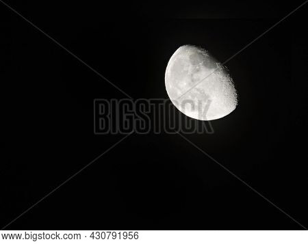 Half Moon And Its Craters, Lighted By Sun, In The Upper Right Corner Of The Picture