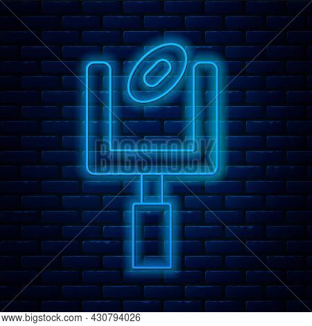 Glowing Neon Line American Football Goal Post And Football Ball Icon Isolated On Brick Wall Backgrou