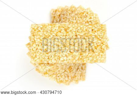 Pile Of Sesame Brittle Bars, From Above, On White Background. Sesame Seed Candy Bars Or Also Crunch,