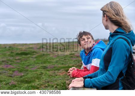 Mother And Preteen Enjoying A Day's Holiday In Nature
