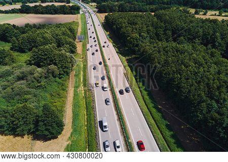 Cars Movement On A Highway, Aerial View. Car Traffic On A Suburban Highway In Summer Day. Logistic A