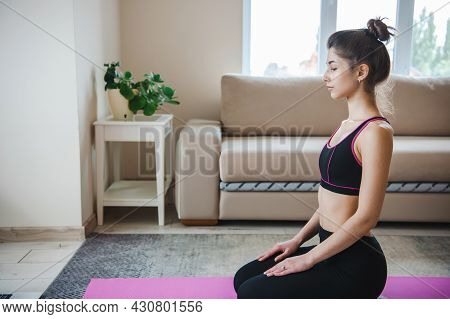 Image With Woman Using Laptop On Floor While Meditating. Online Training. Meditation Practice. Stres