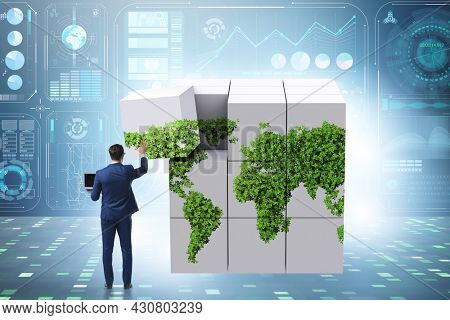 Businessman building world map from cubes