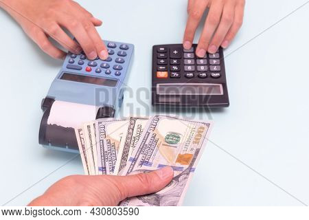Payment For Purchases In Cash. A Hand Giving Cash For A Purchase, A Hand Pressing Buttons On A Cash