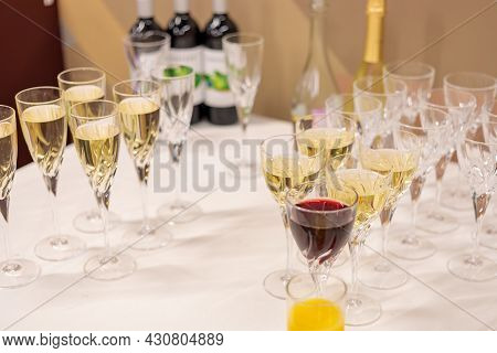 Glasses With Champagne And White Wine On The Table. Corporate, Festive Event. Alcoholic Drinks.