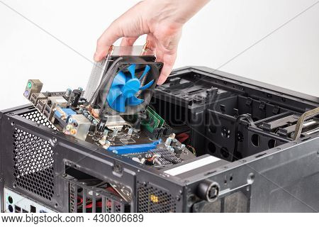 Hand Putting In Or Removing Pc Internals While Maintenance Personal Computer Hardware With Selective
