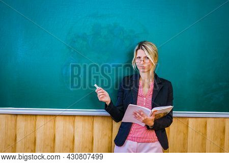 Happy Teacher At The Blackboard In The Classroom Room Back To Class