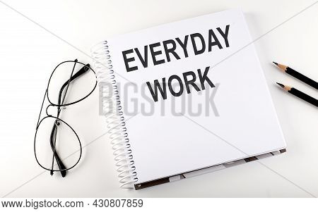 Notepad With Text Everyday Work . White Background. Business
