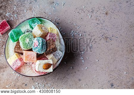 Turkish Delight Of Different Types In A Coconut Bowl, Dark Background, Top View.