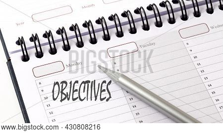 Objectives On Planner With Pencil, Business Concept
