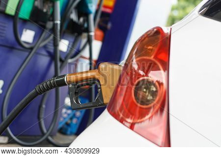 To Fill The Machine With Fuel. Car Fill With Gasoline At A Gas Station. Gas Station Pump.car Gas Fil