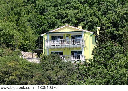 New Large Yellow Suburban Family House With Two Elongated White Front Balconies And Attached Terrace