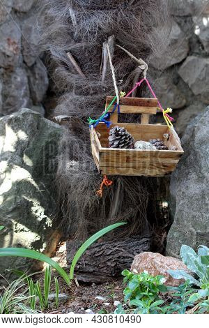 Retro Decorative Vintage Old Wooden Box Filled With Dried Pine Cones And Small Rocks Hang With Color