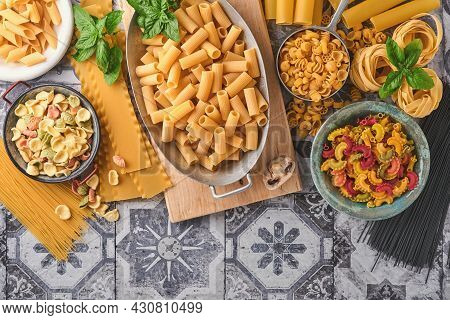 Pasta. Italian Pasta. Variety Of Traditional Italian Pasta: Colorful Spaghetti, Tagliatelle, Farfall