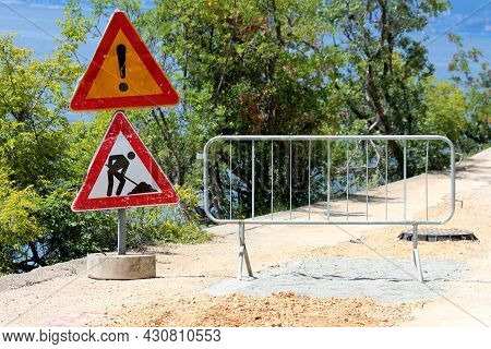 Start Of Closed Road Construction Site With Two Heavily Used Dilapidated Warning Road Works Ahead Ro