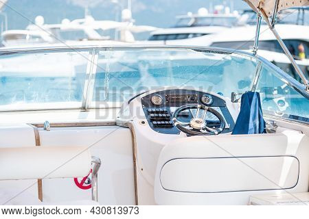 Steering Wheel On Expensive Luxury Yacht Cabin. Detail Of The Interior Of Yacht.