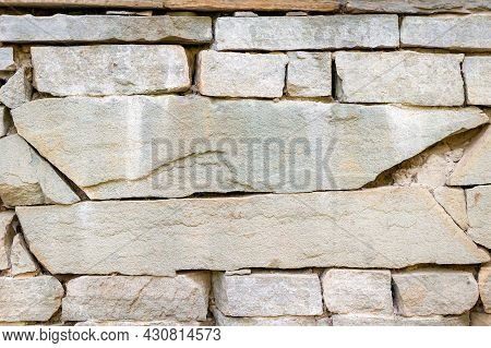 Close Up Of Walls With Masonry Of Stone Bricks Of Different Shapes