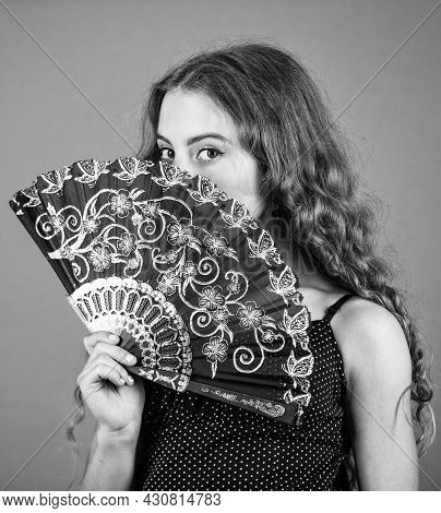 Summer Heat. Fresh Air. Kid Girl Fanning Herself With Fan. Air Circulation. Mysterious Vintage Girl.