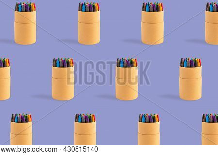 Colored Crayons Pattern Composition On Pastel Purple Background. Waxy Pencils Eco Cardboard Box Isom