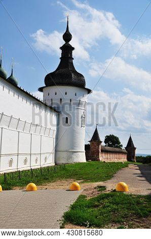 The Walls Of The Rostov Kremlin With Towers. A High White Wall With A Tower And A Wall With Two Red
