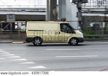 Armored Encashment Truck Ford Transit Is Driving In The City Street. Moscow, Russia - August 2021