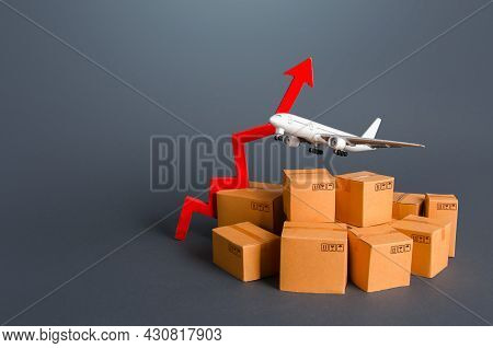 Cargo Airplane Above Boxes And Up Arrow. Growth Of Tariffs For The Transportation Of Goods And Cargo