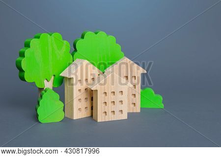 Residential Buildings Among The Trees. Environmentally Friendly, Energy Efficiency, Zero Carbon Emis