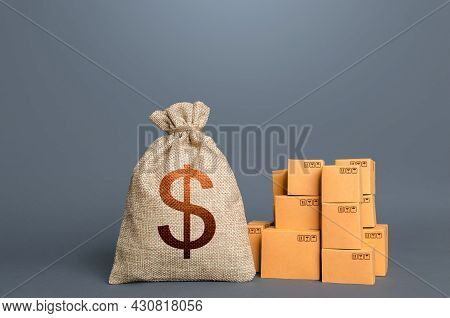 Boxes And Dollar Money Bag. The Concept Of Trade In Goods And Production. Gdp And Economy. Import Ex