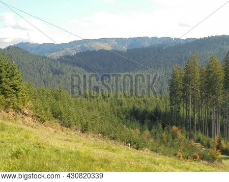 Mountainous Landscape In Beskydy. Magnificent Forests With Behind Meadow. Panoramic Image Of Mountai