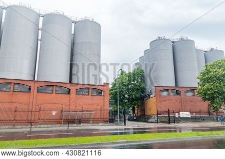 Tychy, Poland - June 5, 2021: Entrance To Brewery Between Fermentation Tanks Of Tyskie Brewery Belon