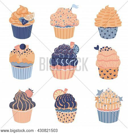 Set Of Cute Little Cupcakes With Cream And Berries. Delicious Dessert With Different Decor. Blue Pas