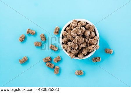 Rye Bran In A Bowl And On A Table On A Blue Background. Diet And Cleansing The Body With Fiber. Top