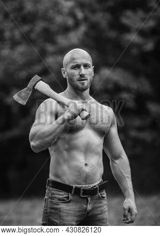 Handsome Shirtless Man Muscular Body. Bodybuilding Sport Concept. Muscular Body. Forester With Axe.
