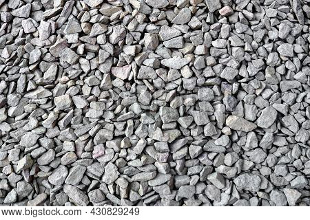Garden Gravel Background Stone Landscaping. Driveway Gravel Road. Crushed Stone Road Building Materi