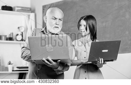Help You Study. New Technology In Learning. School Lesson Online. Search Engine. Small Girl With Man