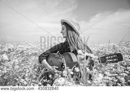 So Happy. Beautiful Woman Play Guitar Among Chamomile Flower Field. Summer Or Spring Nature. Seasona