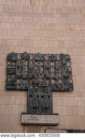 Antwerpen, Belgium - August 1, 2021: Bronze Fresco Againt Brown Wall Of City Theater Celebrates The