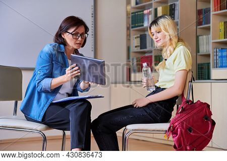 Woman School Psychologist Teacher Talking And Helping Student, Female Teenager